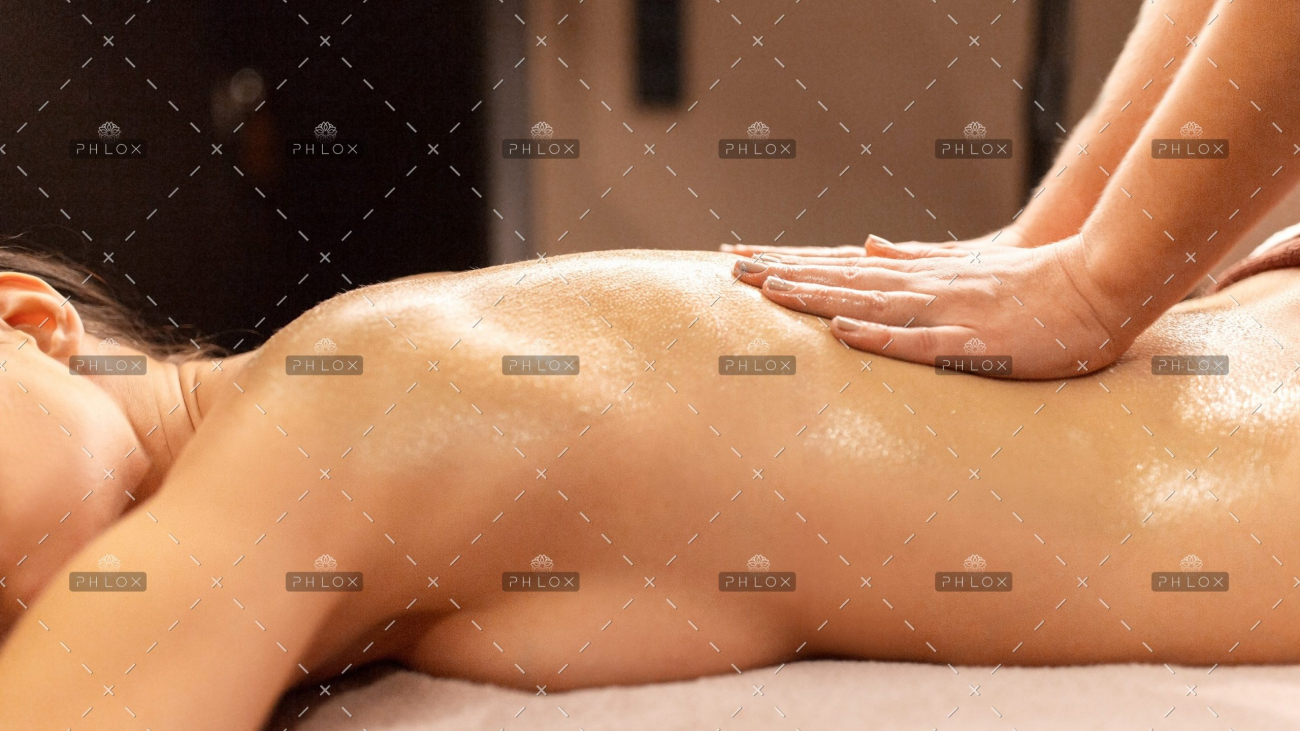demo-attachment-391-woman-lying-and-having-back-massage-at-spa-P9T7TEZ